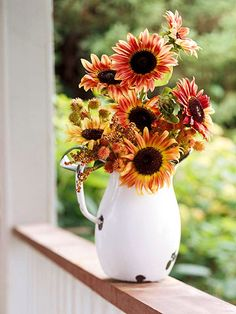 Sunflowers in old pitchers...tried and true happiness.