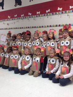 Look at these cute little turkeys! {Broken link :( } Create these by using large brown paper bags. Many grocery stores will give you some if you ask. Then use construction paper to cut out the eyes, beak, and gobble. Create a headband with feathers! How awesome would this be for a Thanksgiving program for parents, guardians, and grandparents during the month of November!!
