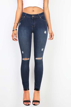 Perfect slim fit stretchy skinny jeans with distressing across the front. Traditional 5 pockets with a button and zip fly closure. Everyday casual jeans that pair well with fitted cropped or flowy top