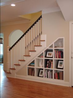 shelves under stairs... I wonder if this is possible under our stairs...  We do have that closet, but it doesn't go all the way back of course.