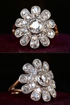 1900s Edwardian 0.75ct European Cut Diamond (G/VS1) Starburst Cluster Ring, 1.40ctw European Cut Diamond Side Stones (F-G, SI1-2), Platinum, 14K Yellow Gold (sold)