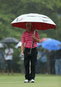 Scott Jamieson of Scotland shelters under his umbrella during the third round of the Volvo Golf Champions at Durban Country Club on January 12, 2013 in Durban, South Africa.