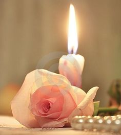 .   ~J  Pretty...candle ,rose , and pearls