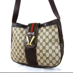Gucci Old Gg Pattern Pvcwebbing Boots Logo Shoulder Bag. Get one of the hottest styles of the season! The Gucci Old Gg Pattern Pvcwebbing Boots Logo Shoulder Bag is a top 10 member favorite on Tradesy. Save on yours before they're sold out! Beige Shoulder Bags, Gucci Shoulder Bag, Gucci Handbags, Vintage Gucci, Best Brand, Diaper Bag, Boots, Pattern, Logo