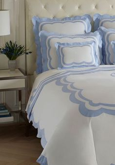 MORGAN Our hand-appliquéd scalloped border creates a bold or subtle effect depending on your choice of 50 Swiss cotton colors.