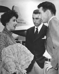 Elizabeth Taylor, brother Howard Taylor, and co-star Montgomery Clift at Idelwild Airport