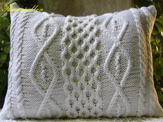 hand knitted pillow on both sides. cushion. Aran reasons. closes with buttons.