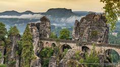 Bastei Bridge, Saxon Switzerland National Park, Elbe Sandstone Mountains, Germany. Photo by Gunter Kirsch. The Bastei has been a tourist attraction for over 200 years. In 1824, a wooden bridge was constructed to link several rocks for the visitors. This bridge was replaced in 1851 by the present Bastei Bridge made of sandstone.