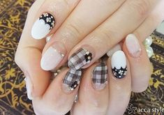 A classy looking black and white inspired gingham nail design. Using white matte as base color the nails are also topped with floral beads and drawings