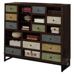 """Multicolored storage unit with 2 doors, 5 drawers, and 10 open compartments.   Product: Storage unitConstruction Material: Pine, MDF and ironColor: Blue, green, cream, yellow and brownFeatures: 11 Drawers10 Storage cubbiesDimensions: 44"""" H x 48"""" W x 15"""" D"""