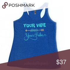 """Your Vibe.."" Racerback Tank Top JUST IN....""Your Vibe Attracts Your Tribe"" Racerback in a French Blue with Turquoise lettering.  Bundle and save 15% in my closet!🛍 Tops Tank Tops"