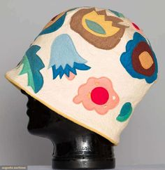 """*  LENCI FELT CLOCHE, ITALY, 1920s White wool w/ colorful felt applique flower blossoms & leaves, gold felt facing, label """"Ars Lenci Made in Italy Torino"""", (scattered round moth holes, some tiny)"""