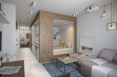 Дизайн прямоугольной студии 30 кв. м. привлекает внимание необычностью и оригинальностью планировки - основной составляющей является конструкция в виде куба, где обустроены кухня и спальня.