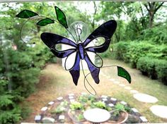 Stained Glass Butterfly Suncatcher by GlassofDistinction on Etsy, $16.95