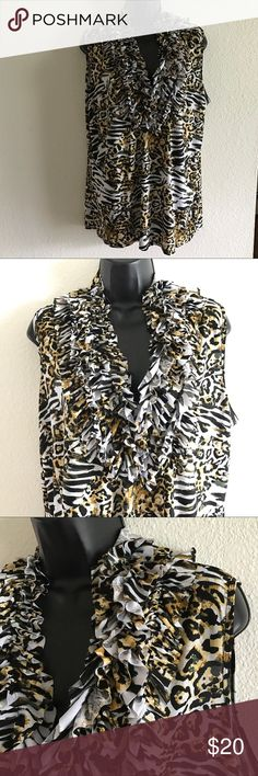 Milano Ruffle Animal Print Tanktop size xl Milano Ruffle Animal Print Tanktop size xl Ruffles around the neck and down the front. Fabric: 95% Polyester 5% Spandex No damage Smoke Free milano Tops Tank Tops