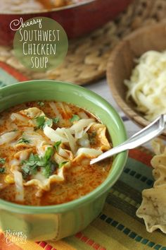 Cheesy Southwest Chicken Soup Recipe - Comfortingsoup filled with chicken, onions, peppers, black beans, corn, and finished off with a little cream to give it that extra little something!