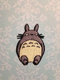 This awesomely adorable Totoro iron-on patch is a great addition to any jacket, backpack, etc.    The embroidered patch is about 3 tall by 2.2