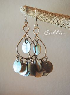 Lovely Beachy boho Silver chandelier earrings and natural shell drops