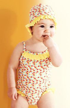 Too cute! One-piece swimsuit with a matching hat.