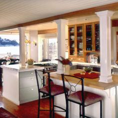 What is more coastal than a floating kitchen? Sturdy white columns, rather than walls, keep this houseboat's interiors from feeling cramped. | Coastalliving.com