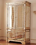Just one piece of mirrored furniture.. Really makes a room pop!