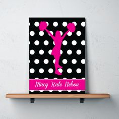 Our personalized polka dotcanvas with a cheerleadersilhouette will look great in your bedroom or dorm room. You can customize it with any colors from our palette or order it in the hot pink, black and white shown.  This cheerleading wall art is perfect for any girl or teen who loves cheer or pom!