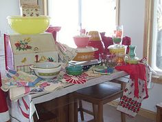Lovely Vintage Display of linens and Pyrex