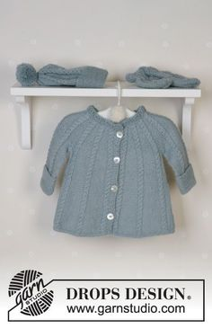c16a456acfa5 DROPS Baby - DROPS jacket in round yoke and cables, hat with pompons,  mittens, socks and blanket in Alpaca and rattle in Muskat or Safran.