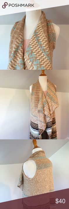 Chunky Knit Anthropologie Vest Funky, cable knit vest from Anthropologie. Light and classic neural colors makes this price a staple for all occasions. Flowy and draped fabric. Size XS/S. Cotton acrylic blend. Hand wash or gentle cycle and lay flat to dry. Anthropologie Jackets & Coats Vests