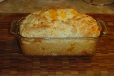 This is Red Lobster's Cheese Biscuit recipe done in a loaf pan.  3 cups flour  1 Tablespoon baking powder  1 teaspoon salt  1/4 teaspoon cayenne pepper  1/8 teaspoon black pepper  4 ounces cheddar cheese, cut into 1/4 inch cubes  1 1/4 cups milk  3/4 cup sour cream  3 Tablespoons of butter, melted  1 egg, lightly beaten