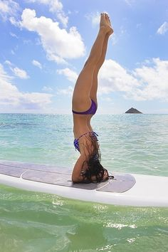 I would love a paddle board so I could move my practice from the mat to the board!  surf board headstand, hawaii style