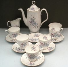 """Buttons and Bows  Designed with delicate rose buds surrounded by bows and ribbons on a white with a thin gold trim. This festive 1950s pattern - says """"It's a Party"""" with it's Blue, Pink, and Grey Bows and Ribbons!  This coffee set would work great at a baby shower or wedding shower!"""