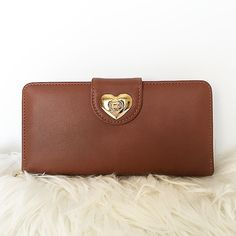 Heart wallet❤️ Heart lock wallet. Twist the little knob of the heart to close the front of the wallet- has 6 slot card holders, and cash pocket, as well as another pocket for change the buttons. On the other size of the wallet it's zips open and has extra storage for money or anything Bags Wallets