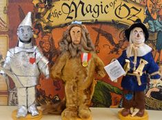 Doll Art Miniatures Wizard of Oz Cowardly Lion, Tin Man, and Scarecrow Set  Fans of the ageless Wizard of Oz story will want to add this adorable hand designed art trio set to their collection. I designed each piece out of clay, wire, paint, and various fabrics and added fine details such as straw, rope, metal axe, and real fiber. Each character stands a tiny and collectible 4 1/2 inches tall (11.4 cm). The Lion has a medal of bravery, the Scarecrow has a genius diploma, and the tin man ...