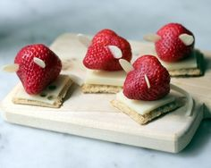 All a strawberry needs to be a mouse is a string cheese tail and almond ears. | 19 Easy And Adorable Animal Snacks To Make With Kids