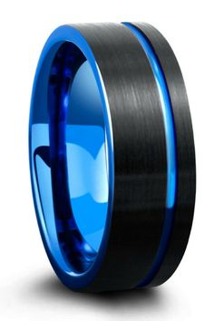 Mens black and blue tungsten carbide wedding ring with a brushed textured top and a blue carved channel groove. This makes such a unique modern looking mens wedding ring.