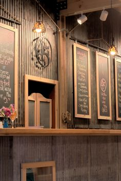 45 North Tasting Room - list of wines are posted on the chalk board Tin Walls, Metal Walls, Sheet Metal Wall, Corrugated Wall, Wine Tasting Room, Garage Bar, Wall Treatments, Restaurant Design, Coffee Shop