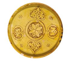 """A rare """"Crusader Ware"""" dish with incised palmette decoration, Syria, 12th century - Sotheby's"""