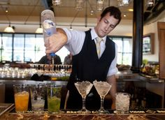 Bartender making some delicious concoctions this winter!
