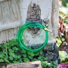Miniature Fairy Garden Green Garden Hose, Wall Attachment by Garden Tools. $4.99. material: Plastic. size: 1.5 inch dia. x 1.5 inch high. scale: 1:12. Ready for watering the garden, washing the dirt off the veggies, or surprising someone with a 'shower,' this little hose will do the job! Wall attachment can be mounted on the the side of your house for hanging your garden hose.