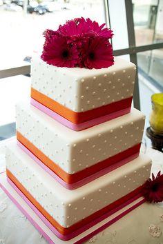 Simple wedding cake with fresh gerbera daisies