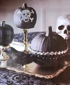 Chic halloween 🎃❤ looks pretty simple to me, spray paint with black a pumpkin and hot glue Rhine stones and make a beautiful chic halloween decor
