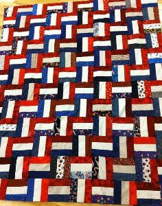 American Rails Quilt - uses 2.5 x 6.5 inch pieces, pieced with white in the middle and laid out with reds right & reds top of every other block. Finishes 60 x 72