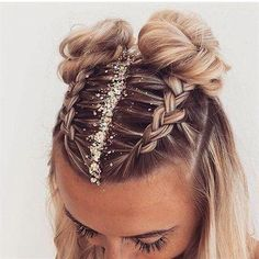 Fun and festive hairstyle for NYE by @charlheaneyibizahair :: NYE Hairstyles for women, NYE hair, Hairstyle inspiration, Hairstyles with glitter, Topknot buns, french braid hairstyles, clip in extensions #Braids #braidedhairstyles