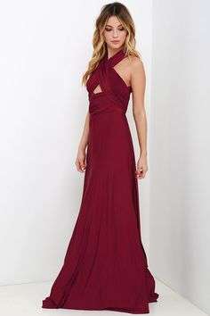 """Any which way you wrap it, the Always Stunning Convertible Burgundy Maxi Dress is one amazing dress! Two, 82"""" long lengths of fabric sprout from an elastic waistband and wrap into dozens of possible bodice styles including halter, one-shoulder, cross-front, strapless, and more. Stretchy burgundy fabric has a satiny sheen, and a full length maxi skirt pairs perfectly with any choice you make up top. Want Styling Tips? <a href='http://bit.ly/HowToWearIt' targ..."""
