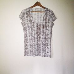☀️$13 w/ Make Offer☀️Snake Print Brown Beige Shirt ➻ Great condition. ➻ Scoop neck. ➻ Short sleeves. ➻ Features vertical snake print throughout.  ➻ No trades. Please refrain from asking. ➻ Negotiations will take place through the 'Offer' button ONLY. Sale prices are firm. Calvin Klein Tops Tees - Short Sleeve