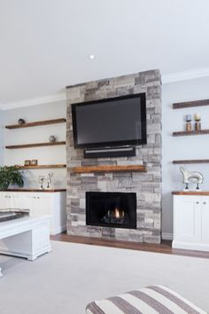 Family room Awesome Dry Stacked Stone Fireplace Ideas - The Urban Interior Grey Stone Fireplace, Stacked Stone Fireplaces, Fireplace Tv Wall, Brick Fireplace Makeover, Fireplace Built Ins, Fireplace Remodel, Living Room With Fireplace, Fireplace Surrounds, Fireplace Design