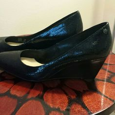 Ladies black wedge dress shoes Ladies black dress wedge shoes, very comfortable, only worn a few times, no longer fit me-  only worn once or twice! Heel height is 2 & a half inches. Calvin Klein Shoes Wedges