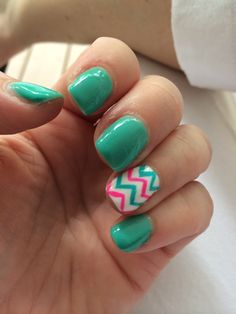 Teal nails with teal and pink chevron
