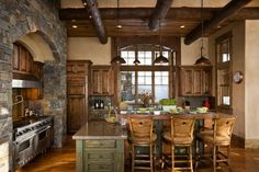 Rustic kitchen...love the beams and stone by gwendolyn